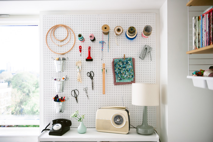 """I hung pegboard in my office for all of my crafty bits and pieces. I'm always making or doing DIY for my blog so this is a very practical storage solution,"" says Katy. ""The phone is an original and still works although no one ever uses a land line anymore."""