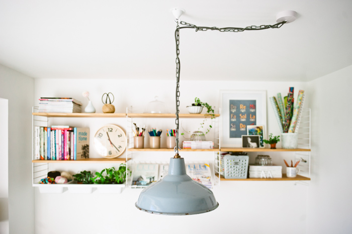 The 1930s factory pendant was a gift to Katy from her old colleagues when she transitioned to working freelance. It adds a bit of edge to this otherwise bright, airy and new space.