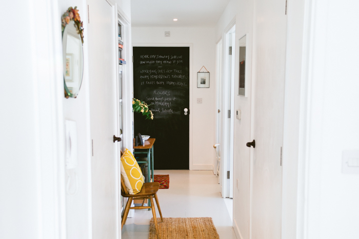 """I painted all of the internal doors in the flat white because there were eight doors leading off our small hallway and so it felt very oppressive,"" says Katy. ""I painted the bathroom door with chalkboard paint as it is right next to the front door so it's perfect for reminders and notes."""