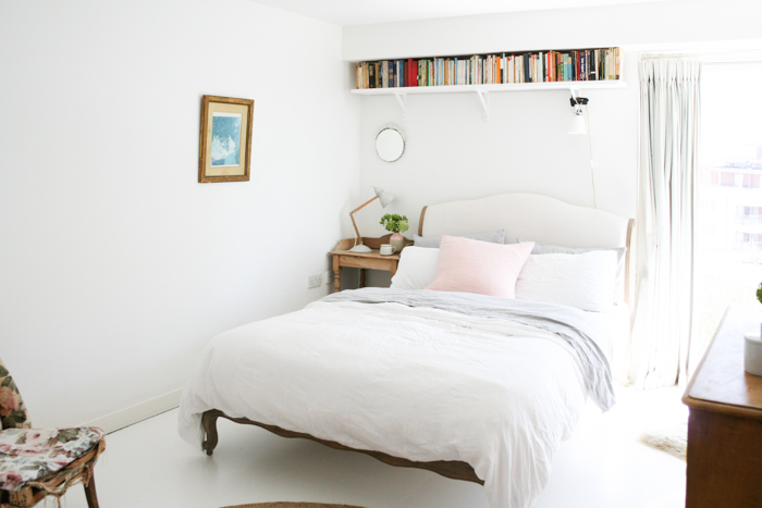 """The bedroom was the last room that I tackled and I loved lightening and brightening it by painting the floors white,"" says Katy."