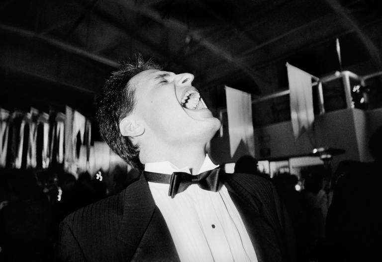 1988 An Adobe Systems employee howls with joy during a toast to the company's spectacular year. Their year-end party was staged at a massive pier in San Francisco and reportedly cost a million dollars. IMAGE: DOUG MENUEZ/CONTOUR BY GETTY IMAGES