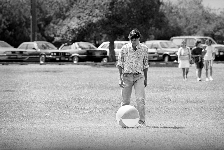 1987 Steve Jobs was not the kind of guy who ever seemed to relax. He was usually focused like a laser on the task at hand. So it was surprising to see him kicking this beach ball around at a company picnic. He seemed to be having a good time, but it felt more like a performance designed to encourage the exhausted team to relax. IMAGE: DOUG MENUEZ/CONTOUR BY GETTY IMAGES