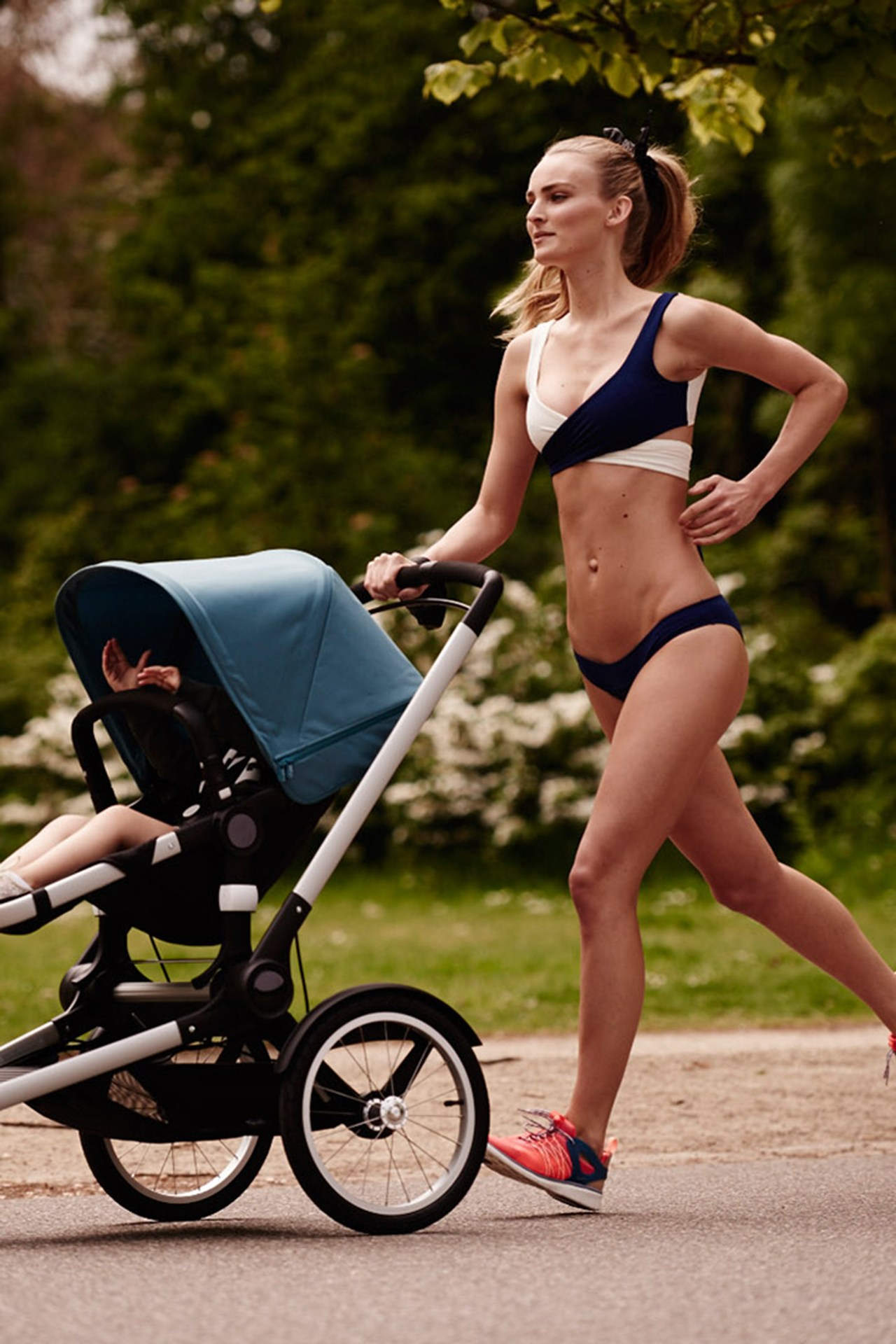 Ymre Stiekema running with her daughter in the buggy Picture credit: Duy Vo/Vogue Netherlands/Bugaboo