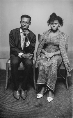 Man and wife seated for one of Alonge's indoor portrait sessions. (Chief Solomon Osagie Alonge, Ideal Photo Studio, Benin City, Nigeria)
