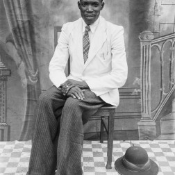 Man seated for an outdoor portrait. (Chief Solomon Osagie Alonge, Ideal Photo Studio, Benin City, Nigeria)