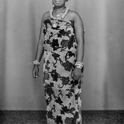 Nigerian woman adorned in jewelry that includes a traditional necklace and headband made of coral. (Chief Solomon Osagie Alonge, Ideal Photo Studio, Benin City, Nigeria)