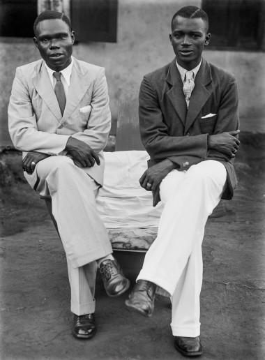 Two men post in one of Alonge's early outdoor studio portrait sessions. (Chief Solomon Osagie Alonge, Ideal Photo Studio, Benin City, Nigeria)
