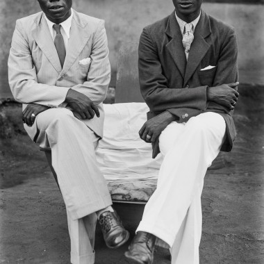 Two men post in one of Alonge's early outdoor studio portrait sessions. (Chief Solomon Osagie Alonge, Ideal Photo Studio, Benin City, Nigeria)