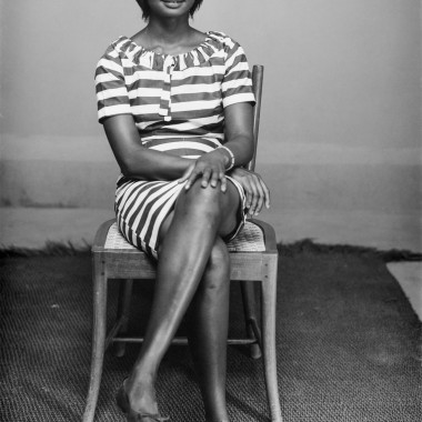 Young woman with crossed legs. (Chief Solomon Osagie Alonge, Ideal Photo Studio, Benin City, Nigeria)