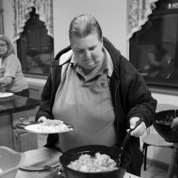 Carol, 65, attends a communal dinner at her transitional housing in Long Island City.
