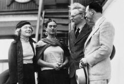 08 Jan 1937, Tampico, Mexico --- Tampico, Mexico: Leon Trotsky, co-leader of Russian revolution 20 years ago, re-entered the new world on January 8, when he arrived at Tampico, Mexico, a refugee driven from one country to another, from Norway. Trotsky, who arrived on the freighter, Ruth with Mrs. Trotsky, (left), is being greeted by Frida Kahlo, wife of the famous Mexican artist Diego Rivera, and Schachtman, leader of American Communist Committee who came to Mexico to receive him. --- Image by © Bettmann/CORBIS © Corbis. All Rights Reserved.