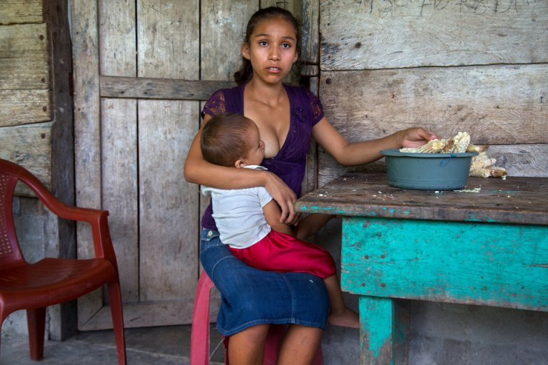 "Aracely, 15, holds her infant. ""What I hope is to keep moving forward... to see how I can get my boy ahead. The hard thing, maybe... when he gets older and he leaves... that's when is going to be hard for me. When he is older. Because he is the one who will help me get ahead. Aracely is one of the half a million of Guatemalan girls who marry and give birth before they can legally vote, drink, or buy cigarettes. According to a 2012 UN Population Fund survey, 30% of Guatemalan women aged 20-24 were married by 18, and that number may be even higher in rural areas. Teenage births are so common that there's even a law requiring mothers under 14 to have C-sections, because their hips are too narrow to give birth."