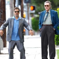 Actors Al Pacino and Christopher Walken walk down the streets