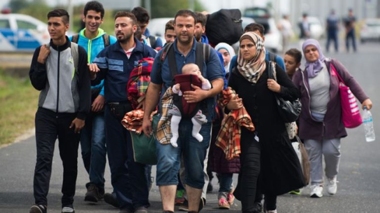 Sept. 14, 2015: Refugees arrive at the border between Austria and Hungary near Heiligenkreuz. (AP/Christian Bruna)