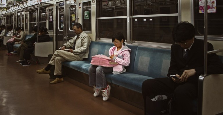 A young girl riding the Tokyo subway alone (tokyoform / Flickr)