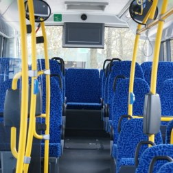 Sitting on the back row of the bus.