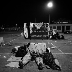 Refugees camp out in the parking lot next to the ferry in Mytilini, Greece. Patrick Witty for BuzzFeed News