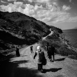 A family of Syrian refugees walk along a dirt road towards a refugee camp in Molyvos, Greece, where buses transport them to the ferry in Mytilini. The walk is several miles long. Patrick Witty for BuzzFeed News