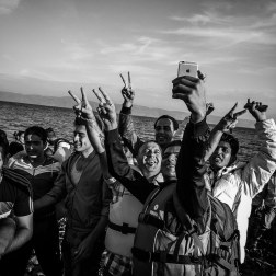 Refugees makes selfies after landing on the coast of Lesbos, Greece. This is a common occurrence with the tech-savvy migrants making their way to Europe. Patrick Witty For Buzzfeed News