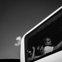 Men and women aboard the bus to Mytilini. Once in Mytilini, the refugees register with Greek authorities and wait to board a ferry to Athens. Patrick Witty for BuzzFeed News