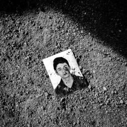 A discarded passport photo on the shore of Lesbos, Greece. No Greek officials meet the refugees when they land on the island, the only official checkpoint is when they are leaving. Patrick Witty for BuzzFeed News