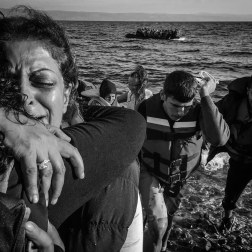 Refugees embrace after landing on the coast of Lesbos, Greece. Hundreds arrived on Sept. 27, 2015. The trip is perilous, rowing across on an overcrowded boat. Many of the boats are inflatable and not intended for such a journey. Patrick Witty for BuzzFeed News
