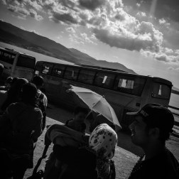 Refugees wait in line for bus to Mytilini at the Oxy Camp in Molyvos, Greece. Patrick Witty for BuzzFeed News