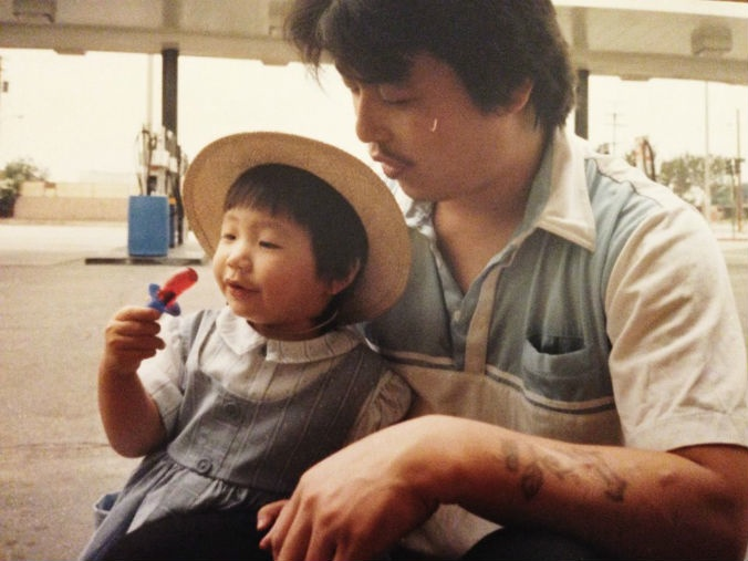 """Kim as a child, photographed with her father. Photo courtesy of Diana Kim, """"The Homeless Paradise."""""""