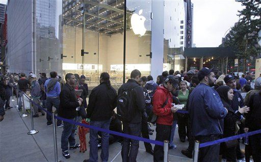 People wait in line to buy the new iPhone 4S outside the Apple store, on New York's Upper West Side,  Friday, Oct. 14, 2011. A faster iPhone with better software and an improved camera went on sale in seven countries on Friday as hundreds of buyers camped out for hours to be among the first to get one.(AP Photo/Richard Drew)