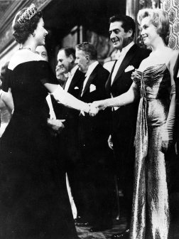 In October of 1956, Marilyn Monroe meets Queen Elizabeth at a film premiere in London. Both women were 30 years old at the time.