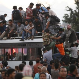 Passengers cram onto one of a few buses in Kathmandu, Nepal. Protests against a new federal constitution have stopped oil reaching the capital.
