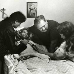 During the early 1990s AIDS epidemic, this father comforts his son who is on his deathbed. Widely considered the photo that changed the face of AIDS, the photo was published in LIFE magazine's November 1990 edition.