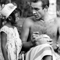 Sean Connery signing a coconut for a Jamaican child on the set of Dr. No in 1962.
