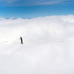 Samuel Volery of Switzerland stands of a tightrope 495 meters long in preparation for the Highline Extreme event in Moleson, Switzerland.