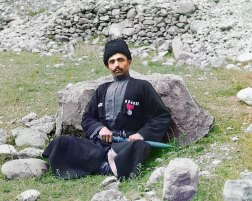 """ca. 1907-1915 Dagestan, meaning """"land of mountains"""" in the Turkic languages, contains a population consisting of many nationalities, including Avars, Lezgi, Noghay, Kumuck and Tabasarans. Pictured here is a Sunni Muslim man of undetermined nationality wearing traditional dress and headgear, with a sheathed dagger at his side. IMAGE: PROKUDIN-GORSKII / LIBRARY OF CONGRESS>"""