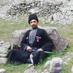 "ca. 1907-1915 Dagestan, meaning ""land of mountains"" in the Turkic languages, contains a population consisting of many nationalities, including Avars, Lezgi, Noghay, Kumuck and Tabasarans. Pictured here is a Sunni Muslim man of undetermined nationality wearing traditional dress and headgear, with a sheathed dagger at his side. IMAGE: PROKUDIN-GORSKII / LIBRARY OF CONGRESS>"