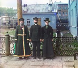 1910 A. P. Kalganov poses with his son and granddaughter for a portrait in the industrial town of Zlatoust in the Ural Mountain region of Russia. The son and granddaughter are employed at the Zlatoust Arms Plant—a major supplier of armaments to the Russian military since the early 1800s. IMAGE: PROKUDIN-GORSKII / LIBRARY OF CONGRESS>