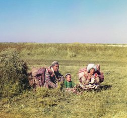 """1911 Many Central Asiatic peoples lived nomadic lives, migrating seasonally from one place to another as opportunities for obtaining food, water, and shelter changed. Shown here is a young Kazakh family in colorful traditional dress moving across the Golodnaia (or """"Hungry"""") steppe in present-day Uzbekistan and Kazakhstan. IMAGE: PROKUDIN-GORSKII / LIBRARY OF CONGRESS>"""
