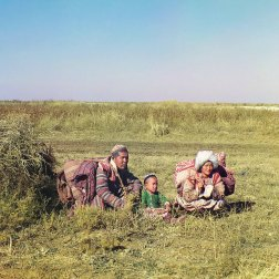 "1911 Many Central Asiatic peoples lived nomadic lives, migrating seasonally from one place to another as opportunities for obtaining food, water, and shelter changed. Shown here is a young Kazakh family in colorful traditional dress moving across the Golodnaia (or ""Hungry"") steppe in present-day Uzbekistan and Kazakhstan. IMAGE: PROKUDIN-GORSKII / LIBRARY OF CONGRESS>"