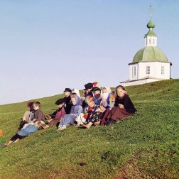 1909 Children sit on the side of a hill near a church and bell-tower in the countryside near White Lake, in the north of European Russia. IMAGE: PROKUDIN-GORSKII / LIBRARY OF CONGRESS>