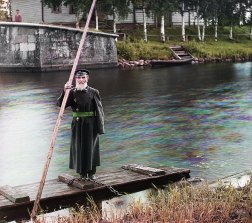 1909 Pinkhus Karlinskii, the supervisor of the Chernigov floodgate, stands by a ferry dock along the Mariinskii Canal system in the northern part of European Russia. In the photo album of his tour of the canal system, Prokudin-Gorskii noted that Karlinskii was 84 years old and had served for 66 years. IMAGE: PROKUDIN-GORSKII / LIBRARY OF CONGRESS>