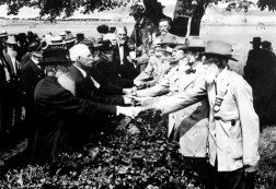 On the 50th anniversary of the battle of Gettysburg, veterans of the Union and Confederacy reunite civilly, and shake hands. [1913]