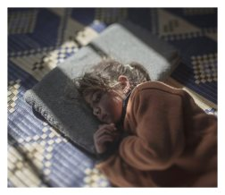 Tamam, 5 years old,Azraq. Five-year-old Tamam is scared of her pillow. She cries every night at bedtime. The air raids on her hometown of Homs usually took place at night, and although she has been sleeping away from home for nearly two years now, she still doesn't realize that her pillow is not the source of danger.
