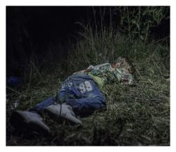 """Horgos, Serbia. It is after midnight when Ahmed falls asleep in the grass. The adults are still sitting around, formulating plans for how they are going to get out of Hungary without registering themselves with the authorities. Ahmed is six years old and carries his own bag over the long stretches that his family walks by foot. """"He is brave and only cries sometimes in the evenings,"""" says his uncle, who has taken care of Ahmed since his father was killed in their hometown Deir ez-Zor in northern Syria."""