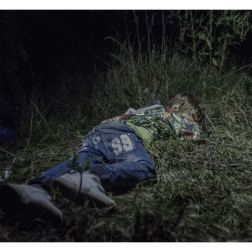 Horgos, Serbia. It is after midnight when Ahmed falls asleep in the grass. The adults are still sitting around, formulating plans for how they are going to get out of Hungary without registering themselves with the authorities. 