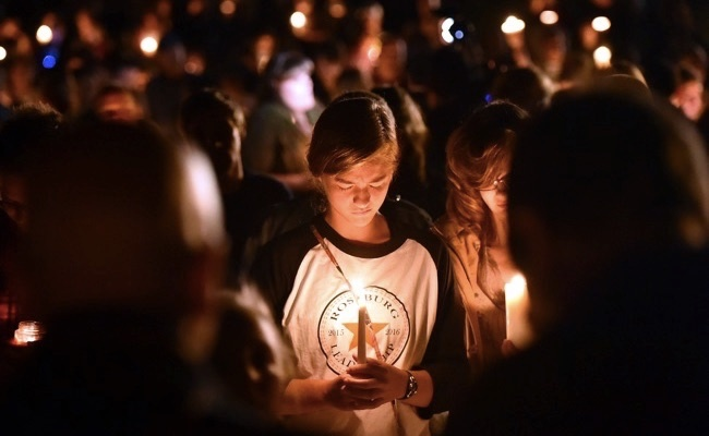 Candelight vigil in Rosen, Oregon. Photo by Josh Edelson/AFP/Getty.